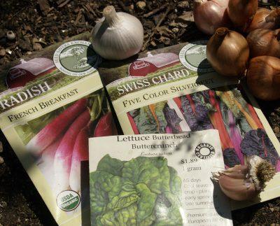 Seed packets, garlic and shallots Central Texas Gardener