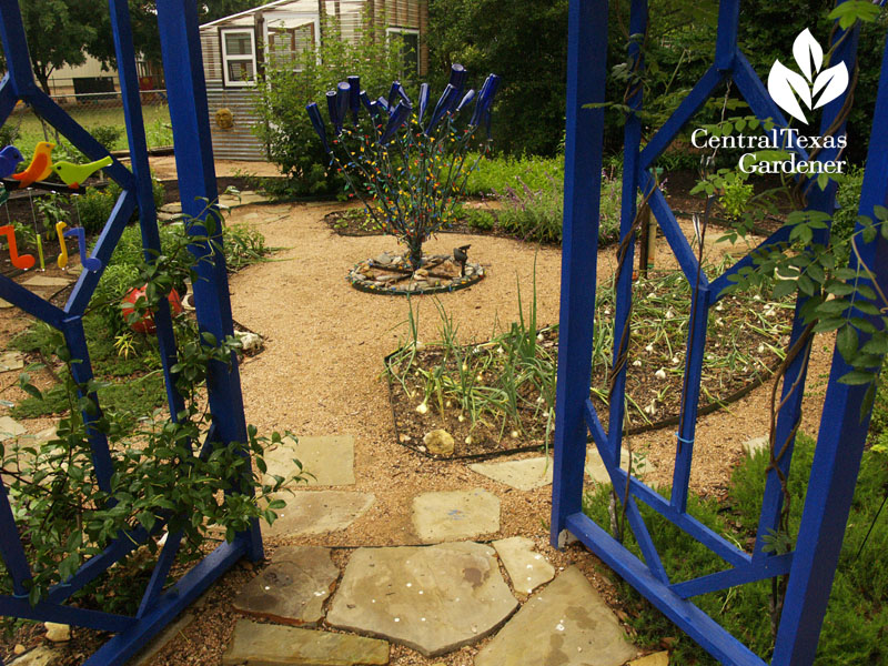Blue gates entrance to vegetable garden