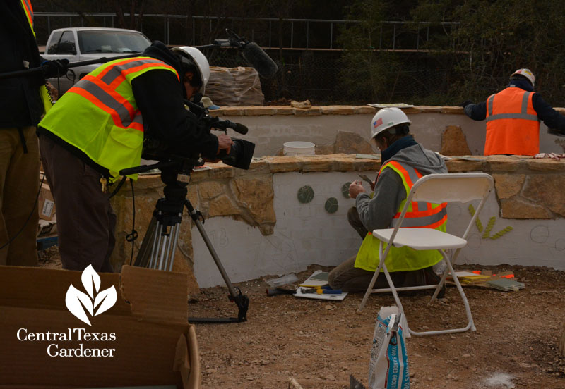 W. Gary Smith landscape architect installing tiles in the Luci & Ian Family Garden