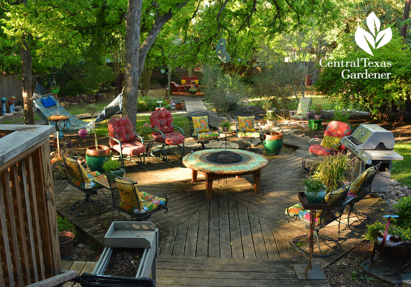 Colorful backyard patio room with handmade fire pit by Sol'stice Garden Expressions