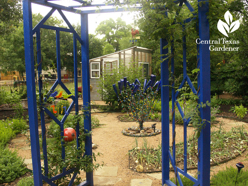 Blue arbor entrance to vegetable garden central texas gardener