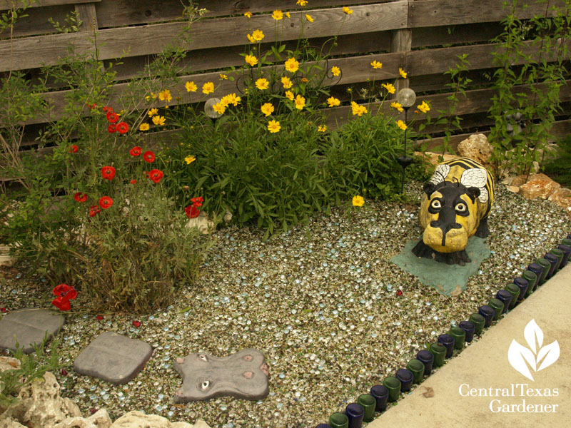 "concrete ""bee"" hippo with coreopsis and poppy central texas gardener"