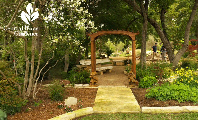 arbor into shady garden Central Texas Gardener