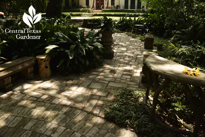 Brick pathway front yard garden with faux bois furniture Central Texas Gardener