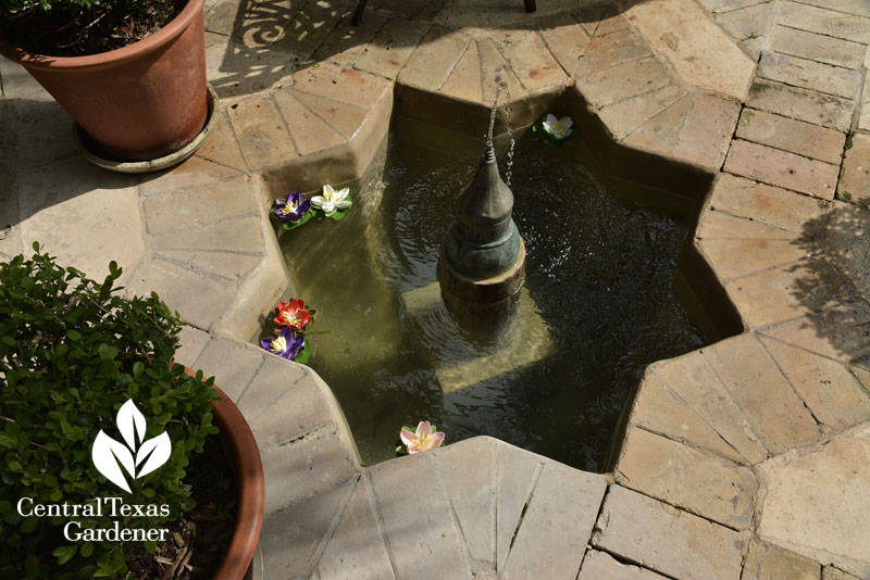 Inset patio fountain Mission style courtyard Central Texas Gardener