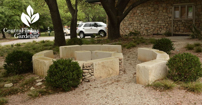 limestone spiral seating under oak trees Rollingwood City Hall Central Texas Gardener