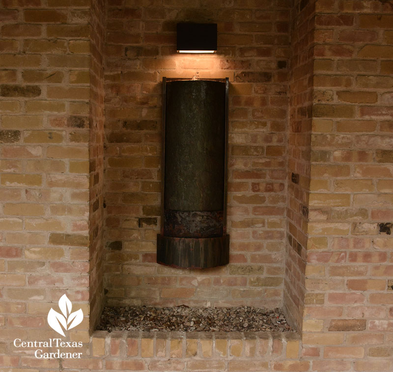 wall waterfall and lighted sconce Central Texas Gardener