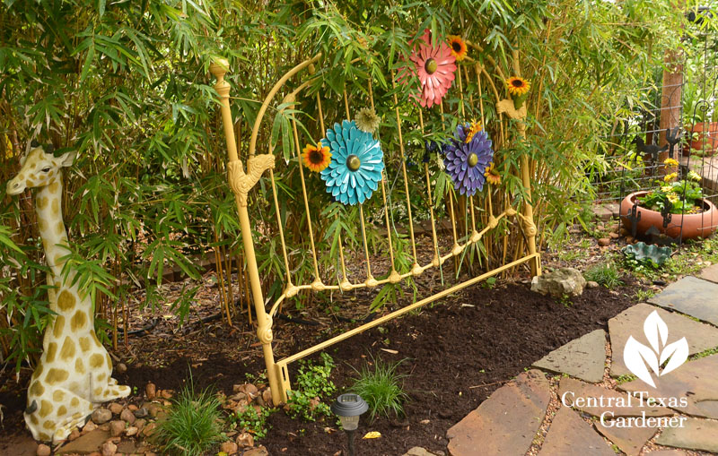 recycled head board garden entrance Central Texas Gardener
