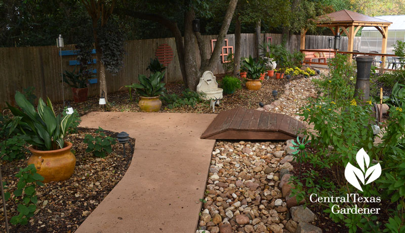 fence art dry creek sidewalk shady garden Central Texas Gardener