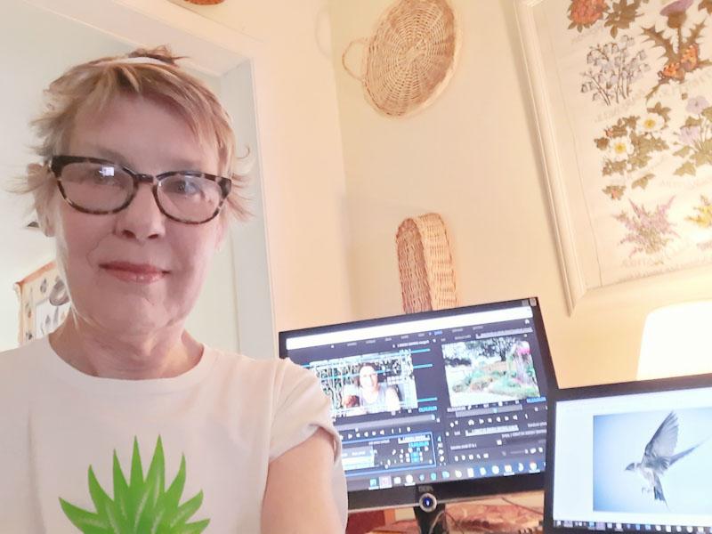 Linda Lehmusvirta editing CTG at kitchen table during quarantine