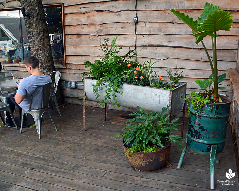 recycled salvages turned into planters Cosmic Coffee + Beer Garden