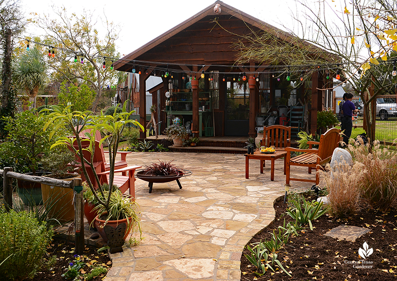 Flagstone path and patio to charming cottage style greenhouse John and Jane Dromgoole Central Texas Gardener