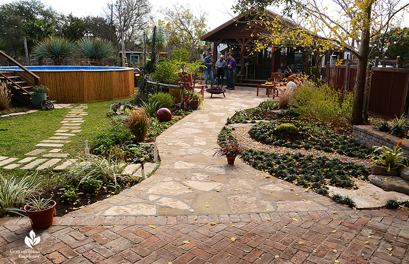 brick patio to flagstone path containers lawn greenhouse Jane and John Dromgoole garden
