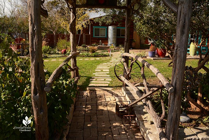 cedar arbor to stone pathway and cistern John and Jane Dromgoole Central Texas Gardener