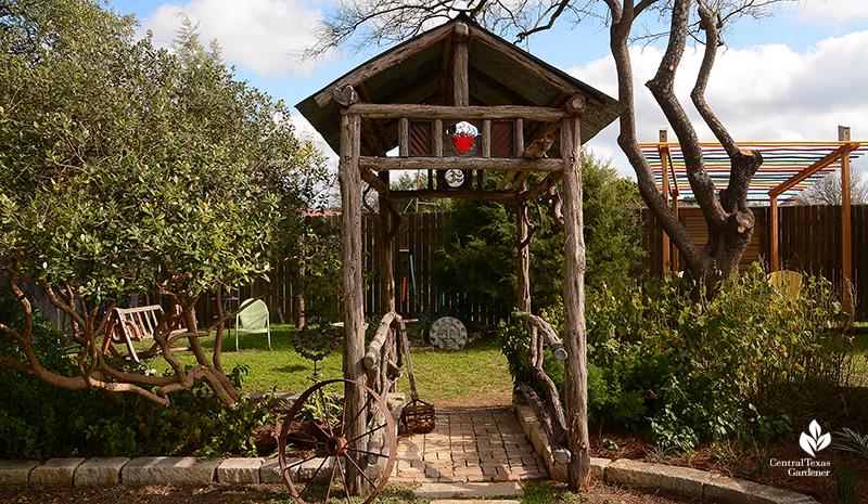 cute cedar arbor to shady cove Jane and John Dromgoole garden Central Texas Gardener