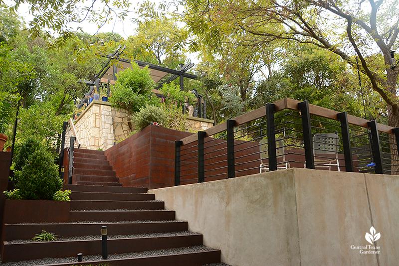 concrete steel limestone tiers sloped backyard living areas Harper Duhon garden Central Texas Gardener