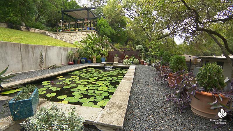 formal pond gravel parterre to stairway sloped backyard design Duhon Harper garden