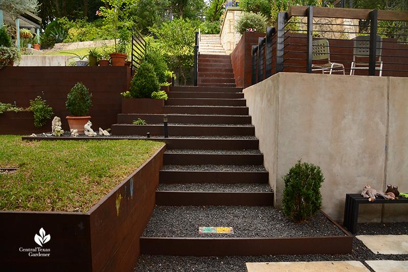 steel and gravel stairway up to living areas sloped backyard Dujon Harper