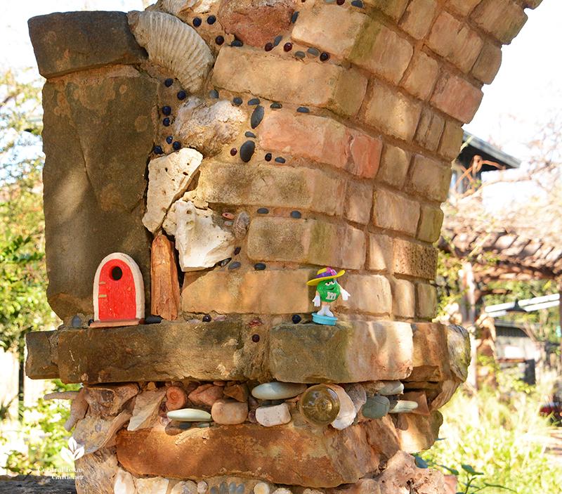 whimsical trinkets family memories folk art stone arch column Jill Nokes Central Texas Gardener
