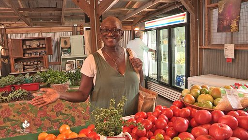 Yolanda Nagy of Eatin and Sippin Locally at Boggy Creek Farm stand Central Texas Gardener