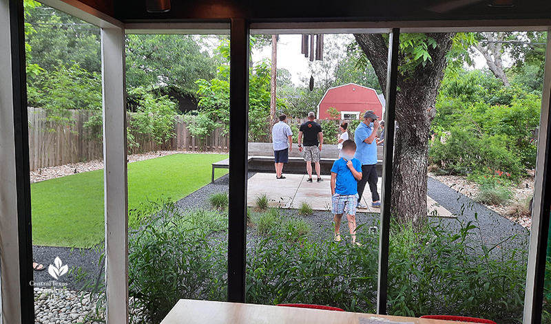 screened in porch to backyard pecan tree Texas basalt path concrete path and wide bench and wall native plants Open Envelope Studio