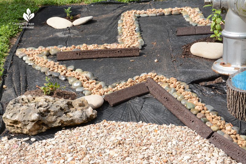 texas shape with rocks on lawn